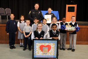 All Saints Catholic School honors the Manassas City Police Department.
